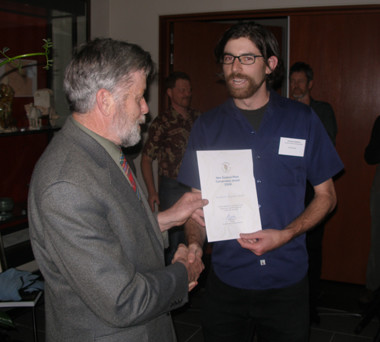 Ian Spellerberg presents the Council award to Jonathan Boow (there on behalf of the Auckland Regional Council).